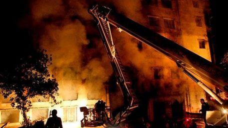 Bangladeshi firefighters battle a fire at a garment
