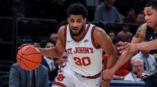 St. John's guard LJ Figueroa drives to the