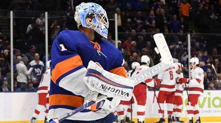 Islanders goaltender Thomas Greiss skates away from the