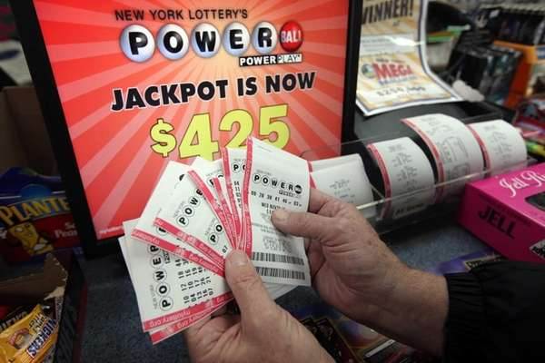 Mike Flannery, of Lindenhurst, fans out the Powerball