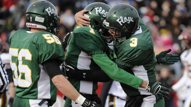 Floyd quarterback A.J. Otranto, right, congratulates Vantrell Nash,