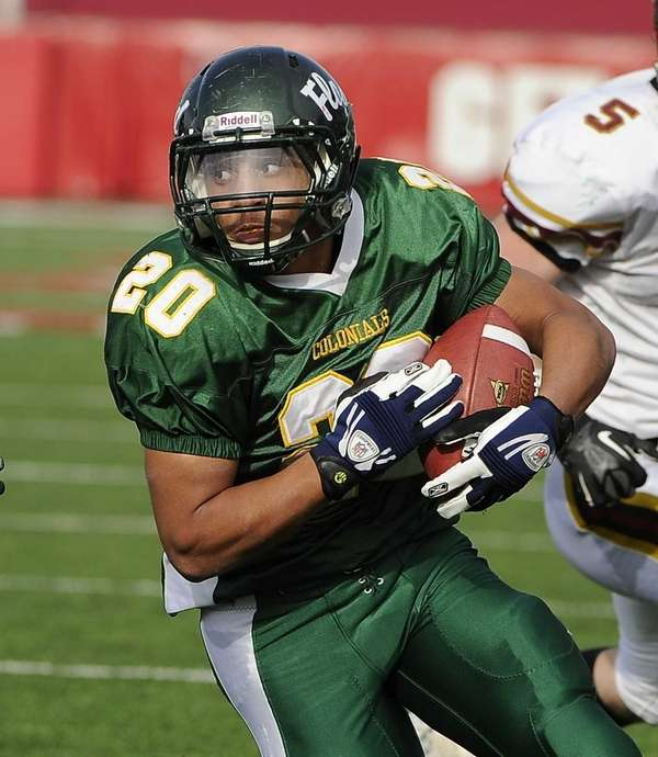 William Floyd's Chris Faison rushes for a third-quarter