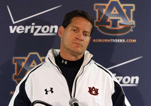 Auburn coach Gene Chizik talks to the media