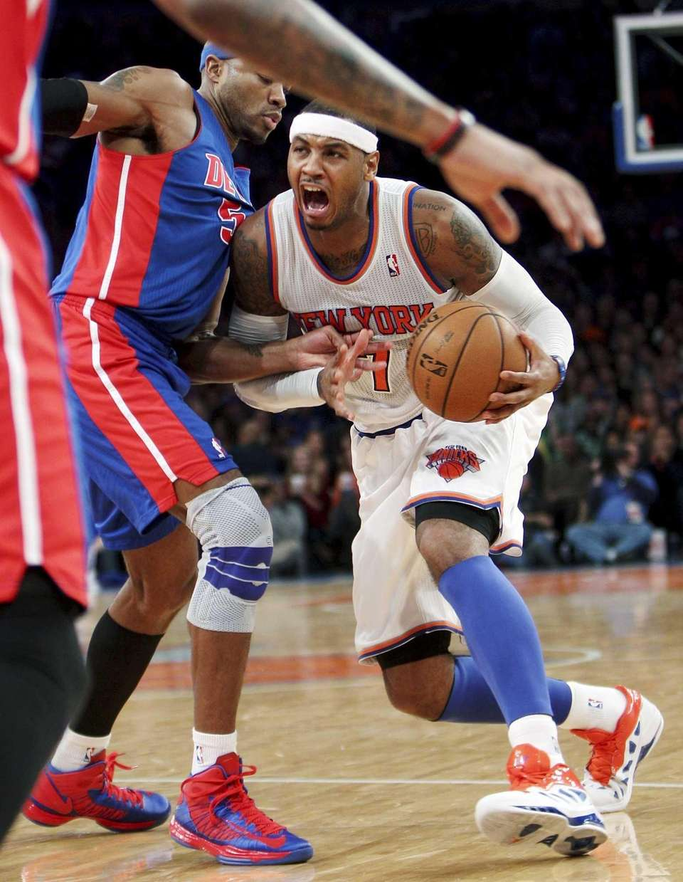 Carmelo Anthony, right, looks to get past Detroit's