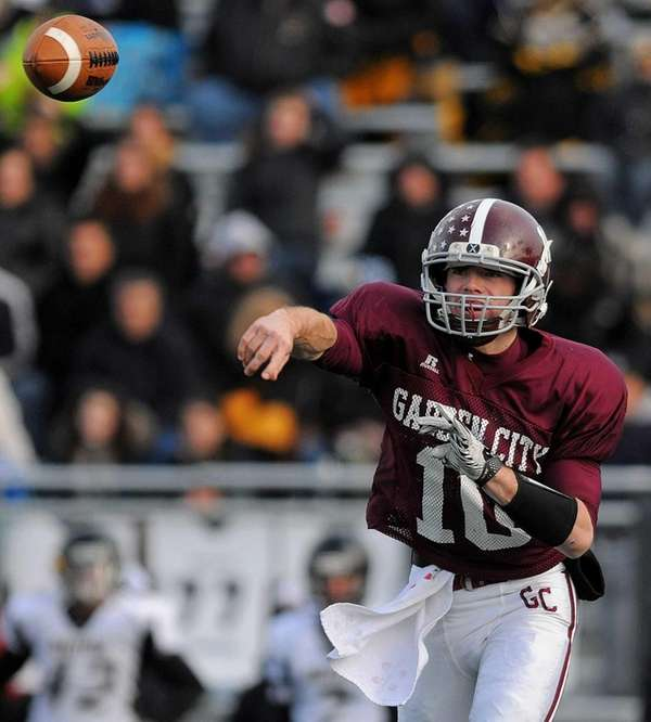 Garden City quarterback Brett Stewart throws a pass