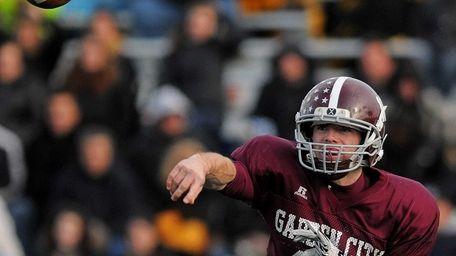 Garden City quarterback Brett Stewart throws a pass
