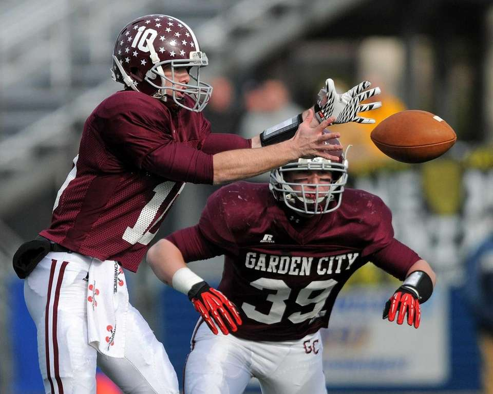 Garden City quarterback Brett Stewart, left, takes the