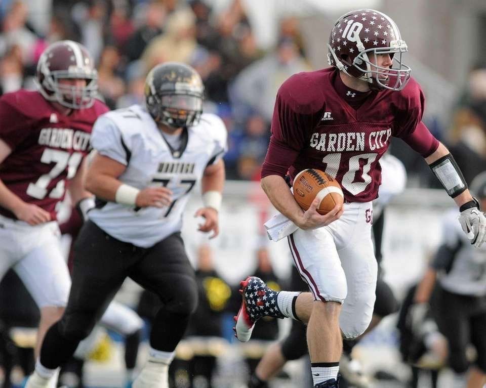 Garden City quarterback Brett Stewart scrambles for a