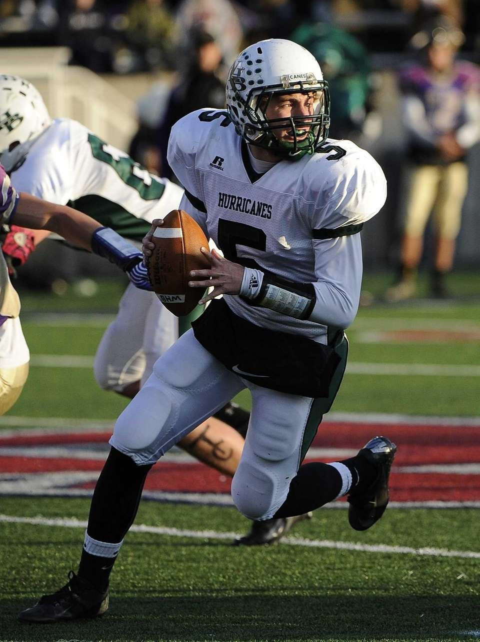 Westhampton quarterback Jack Murphy looks for an open