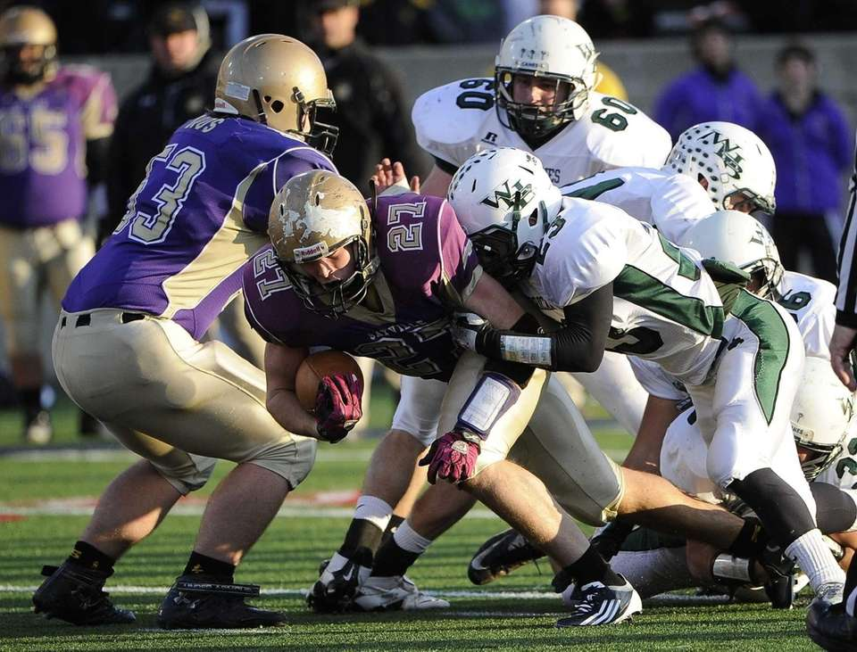 Sayville running back John Haggart drives for extra