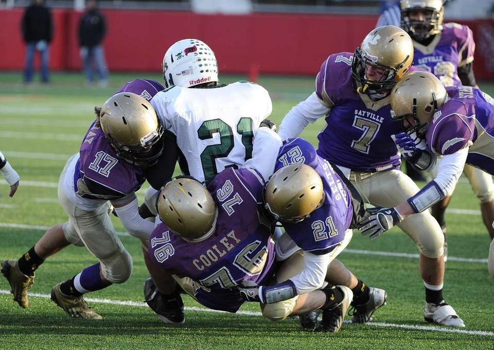 The Sayville defense tackles Westhampton's Evan Gagne in