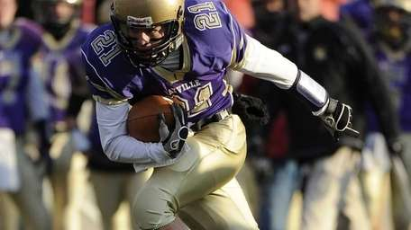 Sayville's Matthew Selts rushes against Westhampton in the