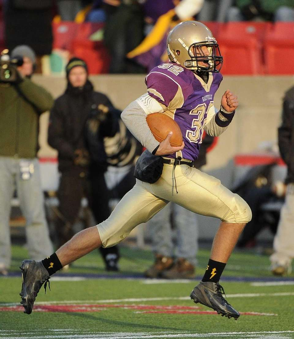Sayville quarterback Zachary Sirico rushes for a 64-yard