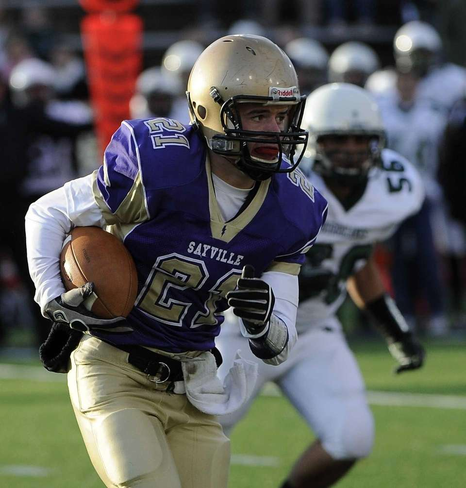 Sayville's Matthew Selts runs the ball against Westhampton