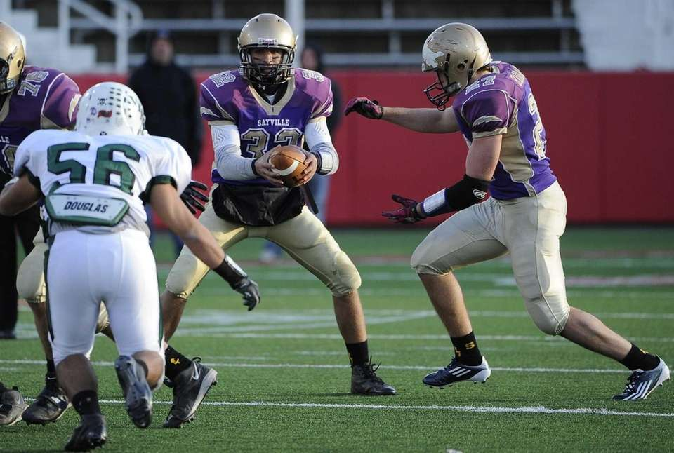 Sayville quarterback Zachary Sirico hands the ball off