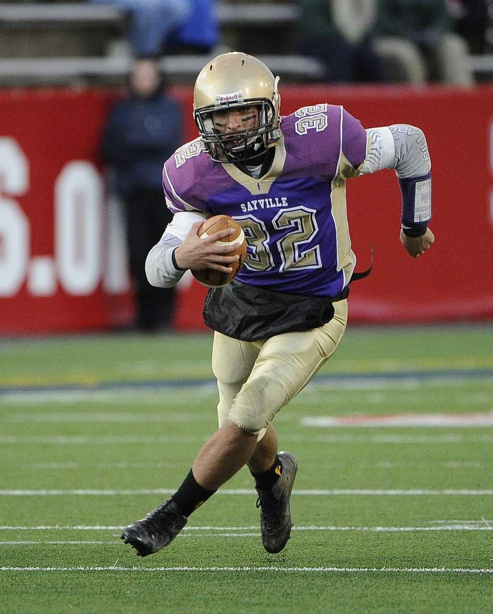Sayville's quarterback Zachary Sirico runs for a gain