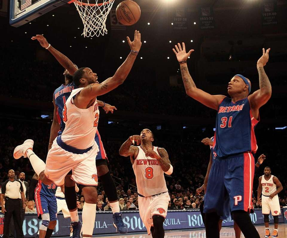Knicks' Marcus Camby hits a reverse layup in