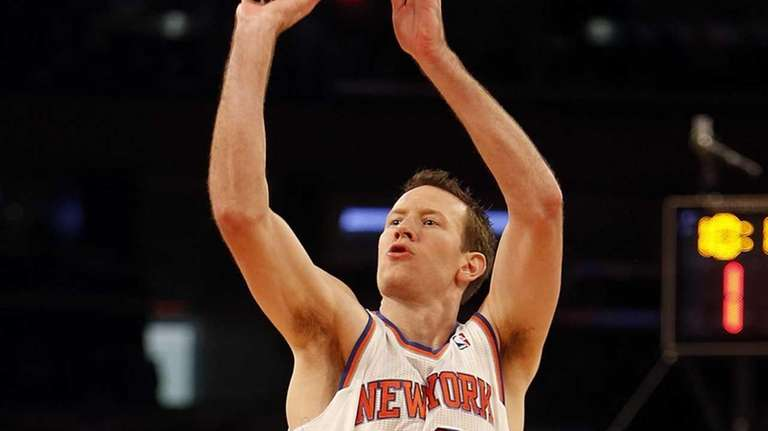 Steve Novak shoots for three in the first