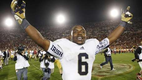 Notre Dame running back Theo Riddick celebrates after