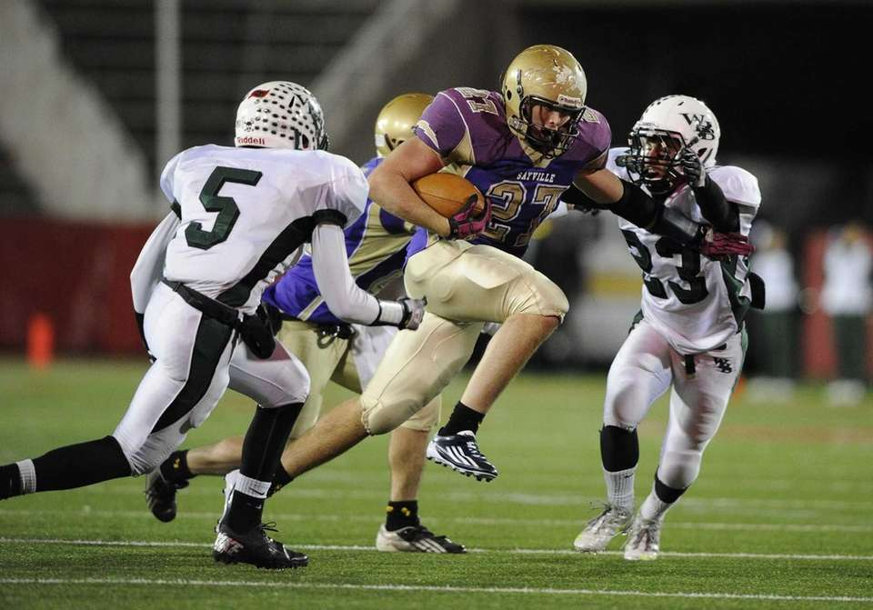 Sayville running back John Haggart rushes against Westhampton