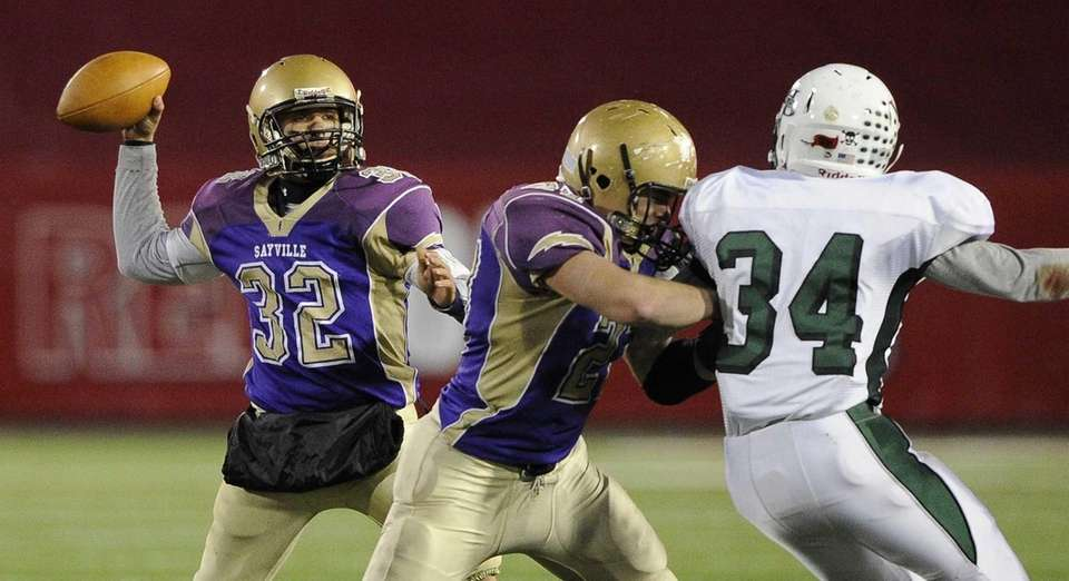 Sayville quarterback Zachary Sirico passes with a block