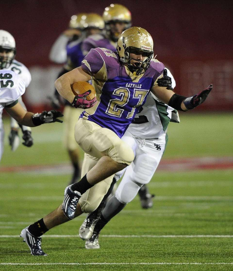 Sayville's running back John Haggart rushes for a