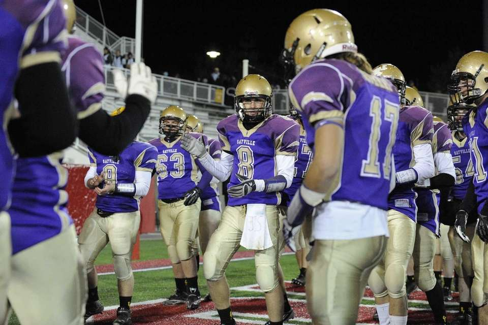 Sayville's Matthew Starr and his teammates celebrate after