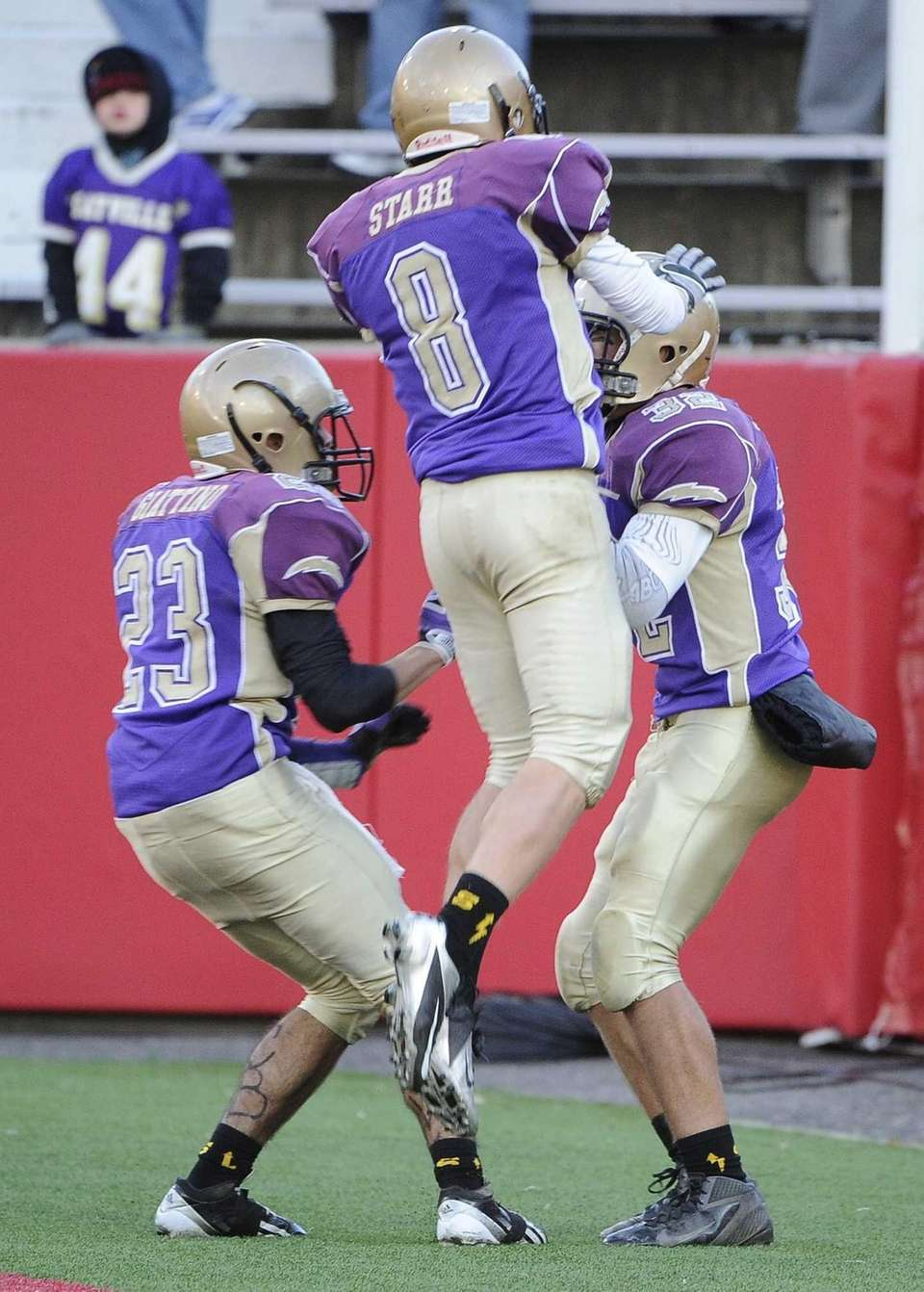 Sayville's James Giattino, left, and Matthew Starr, center,