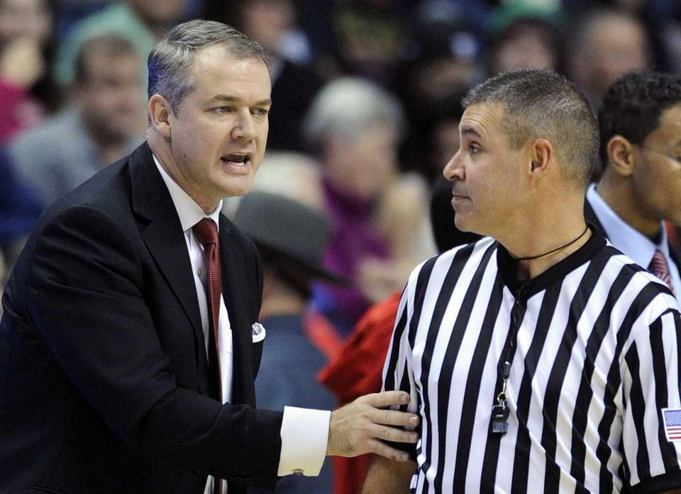 Stony Brook coach Steve Pikiell speaks with an