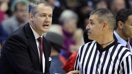Stony Brook coach Steve Pikiell speaks with an