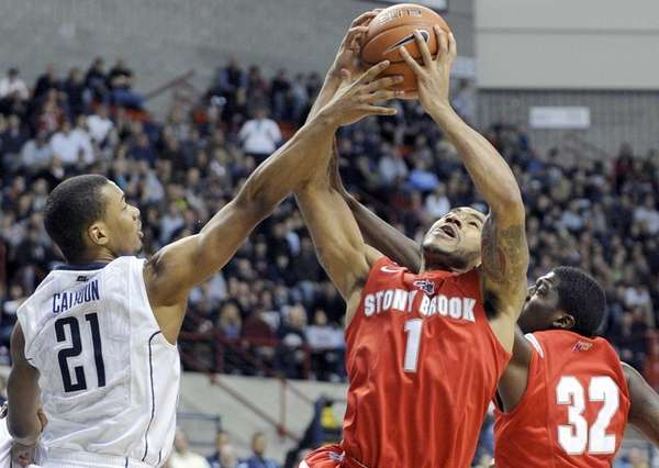Connecticut's Omar Calhoun, left, attempts to block the