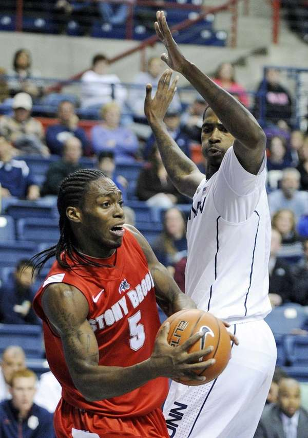 Stony Brook's Dave Coley, left, looks to pass