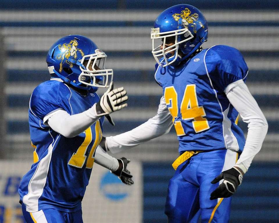 Roosevelt's Marquell Saunders, left, gets congratulated by teammate