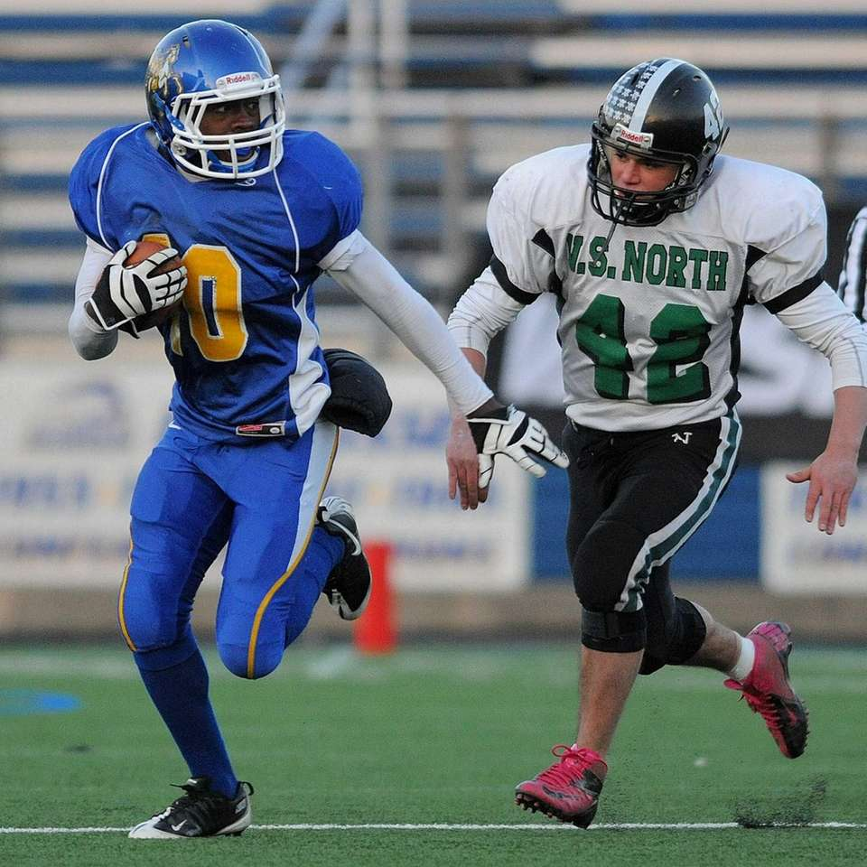 Roosevelt's Marquell Saunders, left, looks to evade Valley