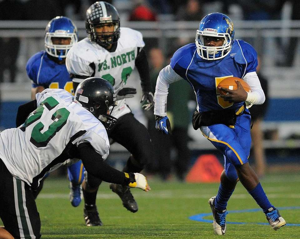 Roosevelt quarterback Justin Terry races upfield in the