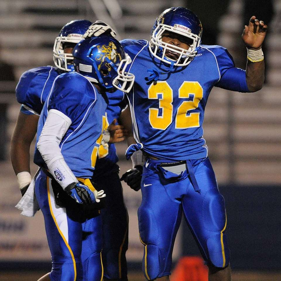 Roosevelt's Johnnie Akins, right, celebrates with teammate Justin