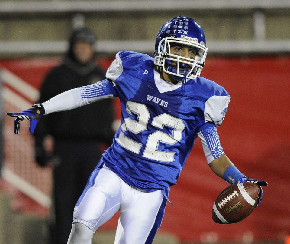 Riverhead's Jeffrey Pittman reacts after he scores a