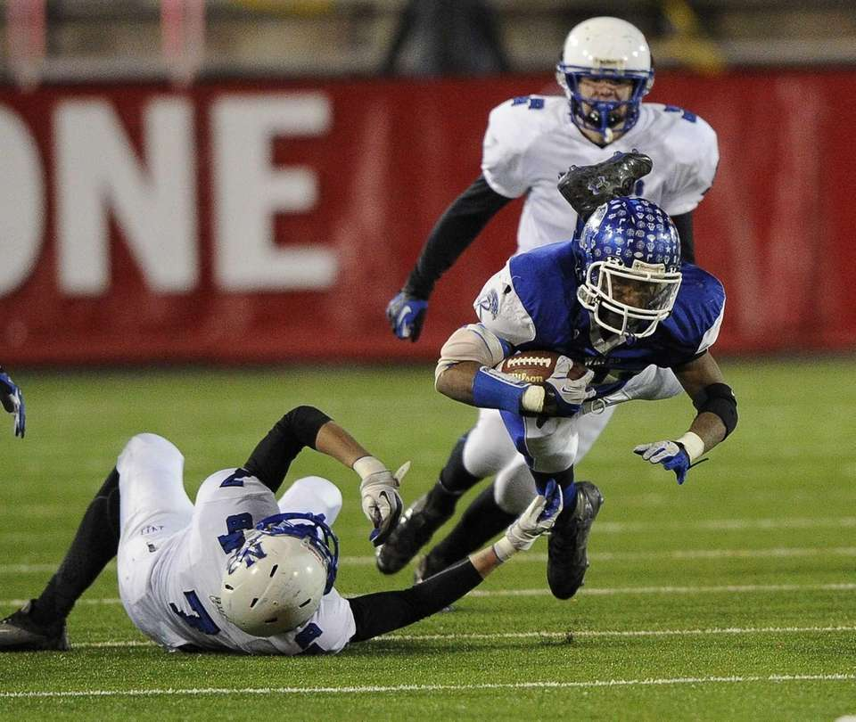 Riverhead's Jeremiah Cheatom is brought down by North