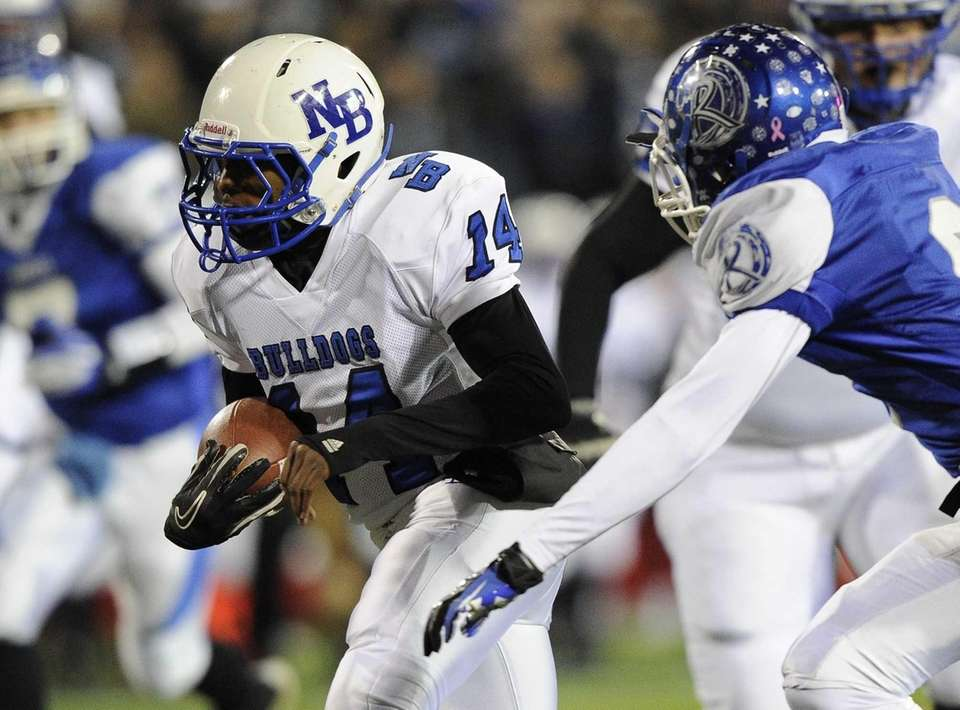 North Babylon's Melijah Pervis rushes for a first-quarter