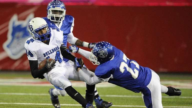 Riverhead's Michael Von Bommel tackles North Babylon's Melijah