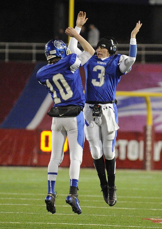 Riverhead quarterback Ryan Bitzer, left, celebrates his second-quarter