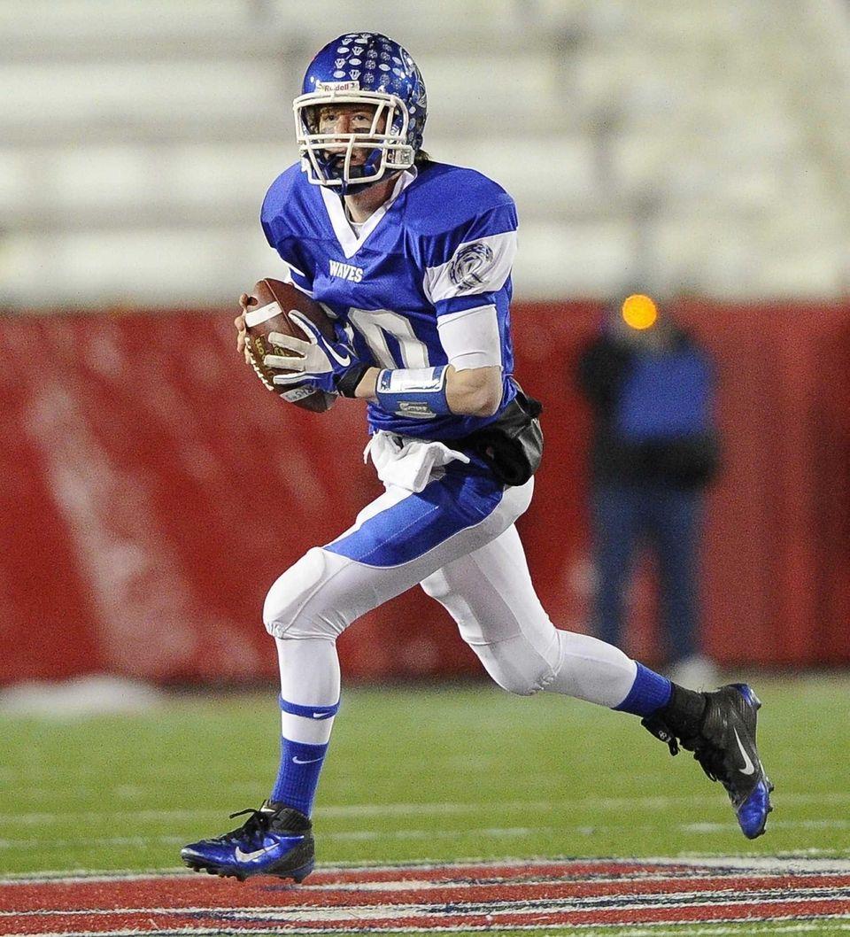 Riverhead's quarterback Ryan Bitzer runs the ball against