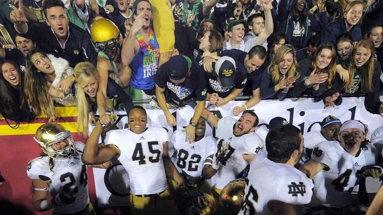 Notre Dame team members celebrate after defeating Southern