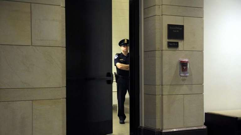 A Capitol Hill Police officer guards a staircase