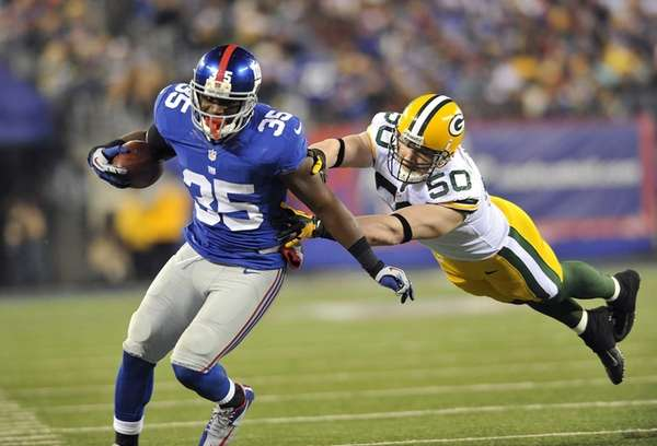 Andre Brown of the Giants is driven out