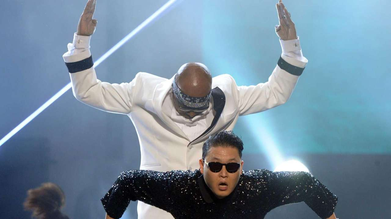 MC Hammer and singer PSY perform onstage during