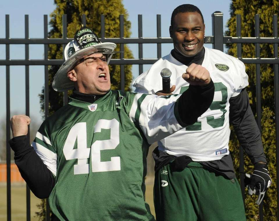 New York Jets fan fireman Ed Anzalone leads