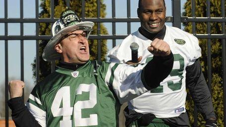 New York Jets fan fireman Ed Anzalone leads