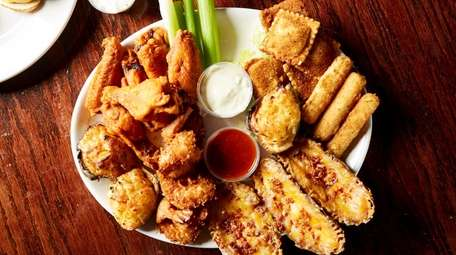 The sampler platter with wings, baked clams, fried