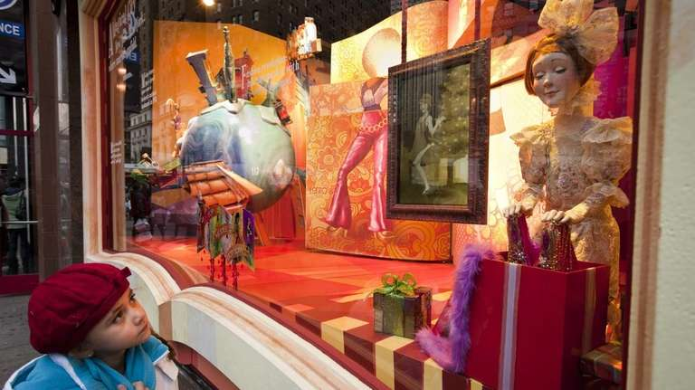 A Macy's holiday window display at Herald Square